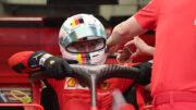 Sebastian Vettel entering on his car at the 2020 Formula One Sakhir Grand Prix.